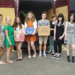Students from Stowupland High School bring their end-of-year food donations